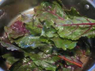 Saute beet greens with garlic