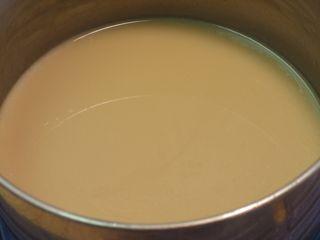 Stir butterscotch as it thickens