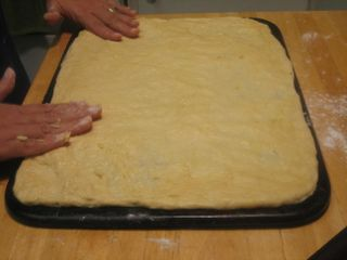 Roll brioche dough onto baking stone or tray