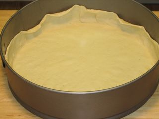 Press down the pastry sheet gently to the bottom & sides of the pan