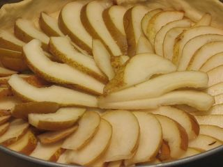 Arrange pear slices radially