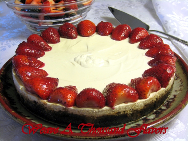 A 'oui, Chef' Inspired Cheesecake ~ A Mascarpone & Orange Cheesecake with a Glossy Sour Cream topping & served heaped with Berries