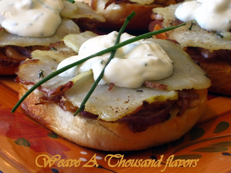 Bagel Pizzas with Caramelized onions, Roasted Potatoes & Herbs topped with a faux Goat Cheese Creme Fraîche