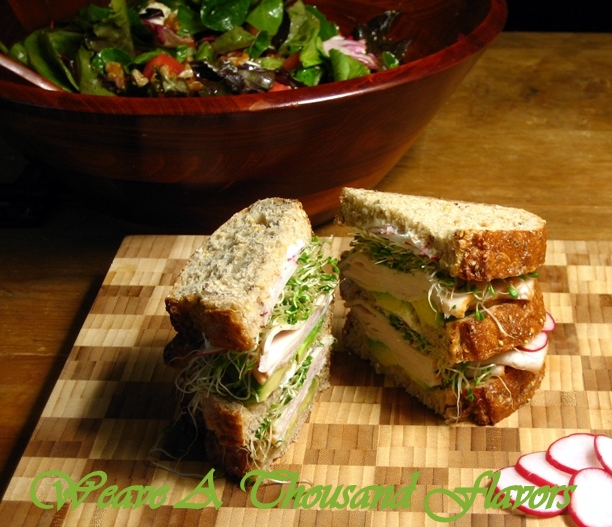 A Turkey, Avocado, Goat Cheese & Radish Sandwich on Wholegrain Loaf Bread