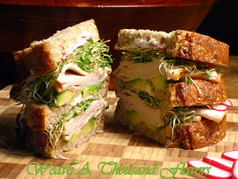 A Turkey, Avocado, Goat Cheese Sandwich on Wholegrain Loaf Bread