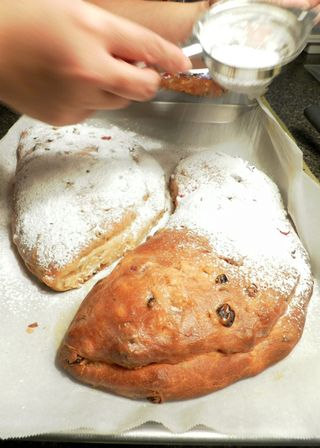 Stollen- rain powdered sugar on hot stollens